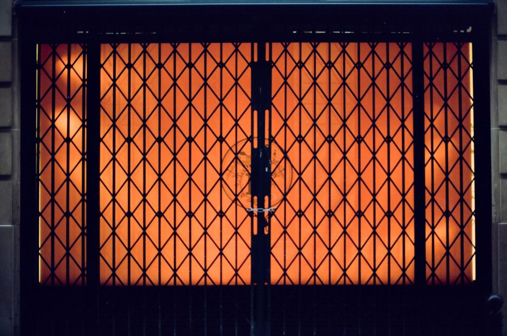 orange and black metal fence